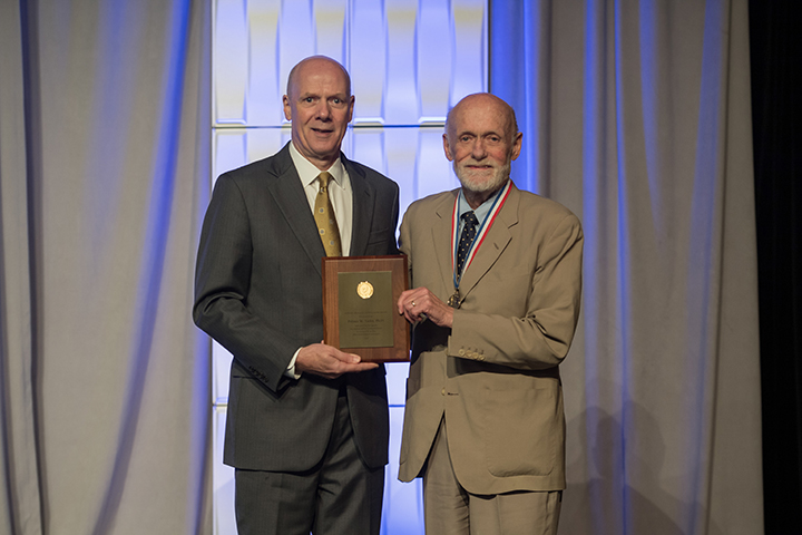 Palmer Taylor (right) accepts the 2017 AACP Volwiler Research Achievement Award from Joseph T. DiPiro, Pharm.D., Dean and Archie O. McCalley Chair, Virginia Commonwealth University School of Pharmacy; and 2016-2017 AACP President.