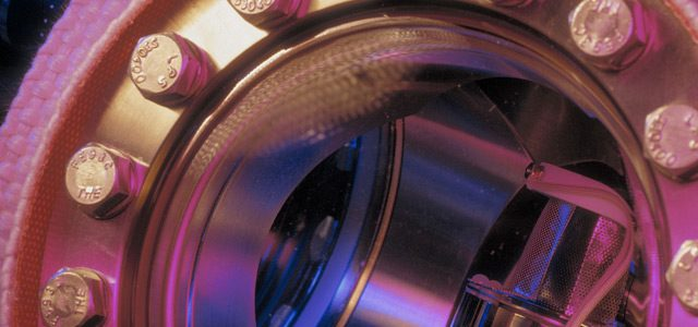 AIC banner image: a mass spectrophotometer glows in a bath of pink and purple light.