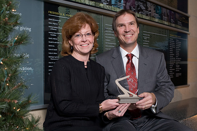 Kathleen Skibinksi, 2008 Alumna of the Year, is congratulated by Phil Berce, PAA immediate past president.
