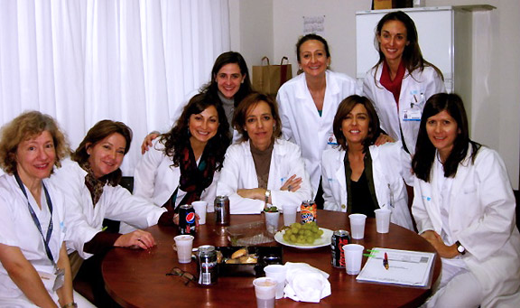 Erica Wagner (3rd from left) sits with pharmacists at the clinic where she spent her 4th-year rotation in Spain.