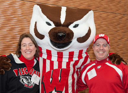 Pharmacy alums pose with Bucky at a Reunion Weekend event.