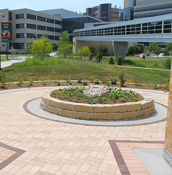 The Legacy Walk is a part of the Medicinal Garden adjacent to the entrance to Rennebohm Hall.