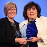 Mary Jo Knobloch (left) receiving her award from APIC President Linda Greene, RN, MPS, CIC, FAPIC. Photo courtesy of Solares Photography Inc.