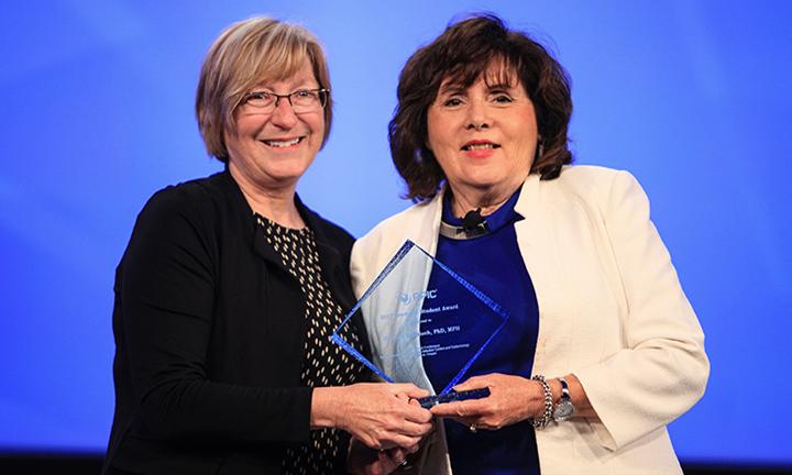 photo of Mary Jo Knobloch receiving award
