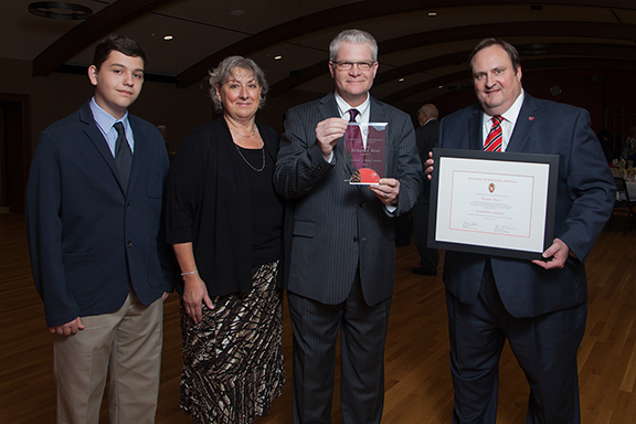 Citation recipient Richard Bertz (second from right) with his son, wife, and Dean Steve Swanson (right)