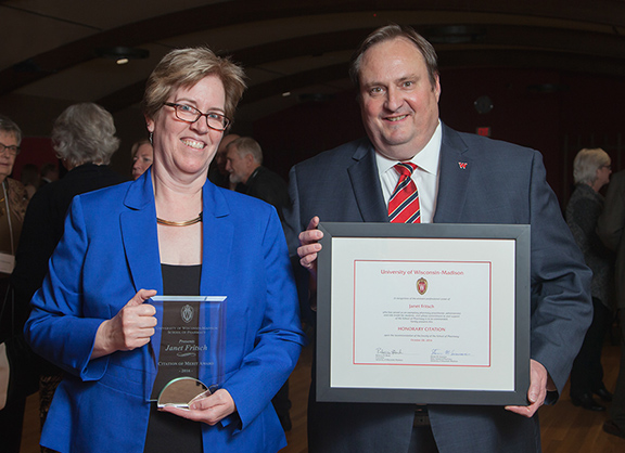 Citation recipient Janet Fritsch (left) with Casey Gallimore of the Pharmacy Practice Division (right)