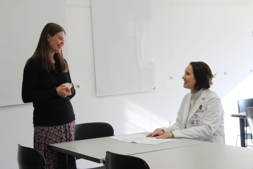Andrea Porter speaking with a pharmacy student during the telepharmacy simulation.