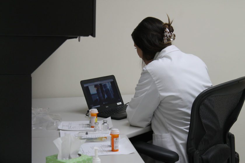A PharmD student completing the telepharmacy simulation.