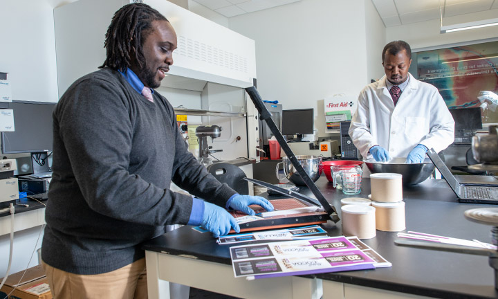 UW-Madison Pharmaceutical Sciences graduate Kwadwo Owusu-Ofori (PhD '10) at his Milwaukee-based startup company Satori Food Project, which makes family-friendly foods that have mental health benefits.