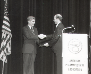 George Zografi accepting award from the American Pharmaceutical Association.
