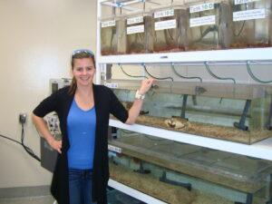 Amanda Buchburger with the crab tank.