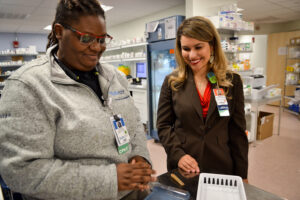 Melissa Ortega (right) with a colleague at Tufts Medical Center