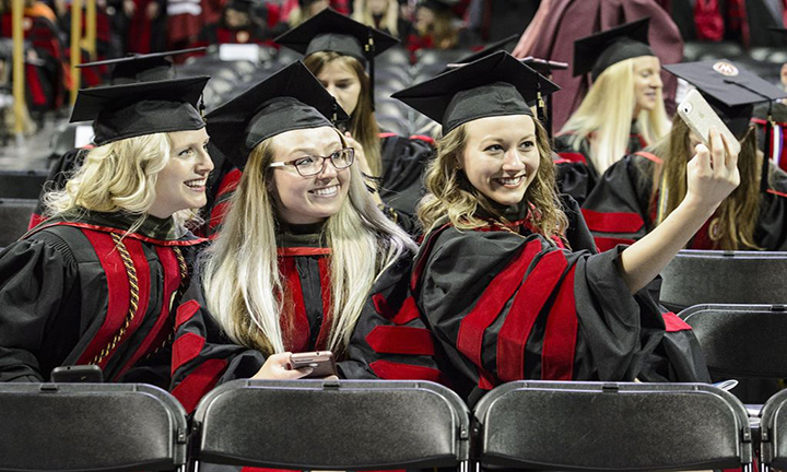 Pharmacy doctoral graduates Taryn Hinners, Lauren Arndt, and Amy Hoffman (left-right) take a selfie at the Kohl Center.