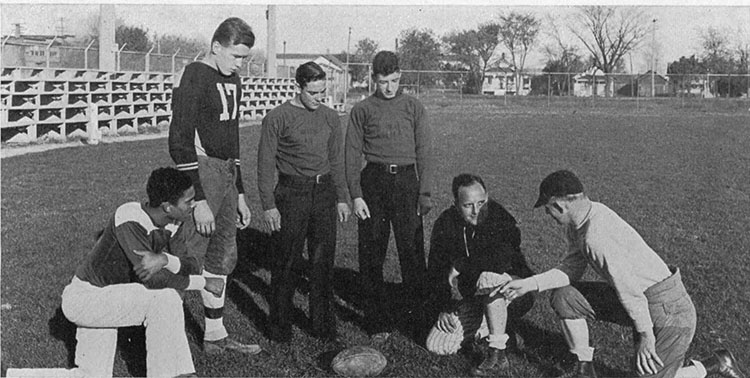 James Buchanan (left, kneeling) with the Menasha High School football coaching staff in 1934.