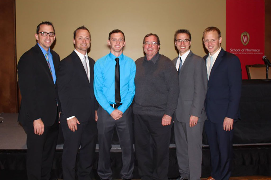 Justin, Derek, Paul, Bryan, and Jonathan Konkol with their father.