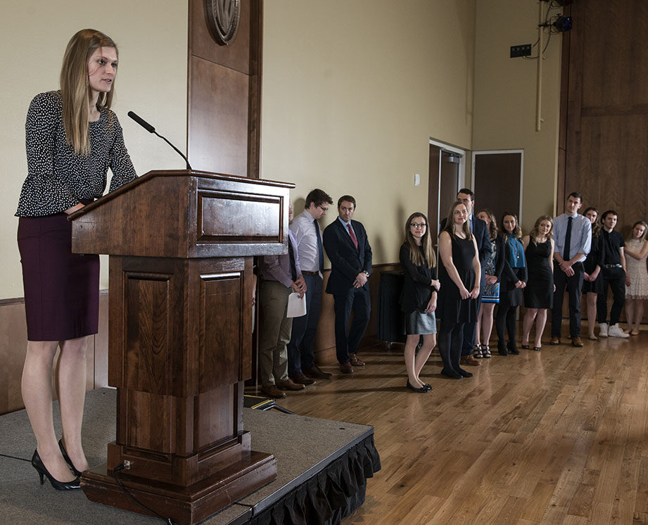 A 2018 Rho Chi Pharmacy Honor Society member gives a speech during the Initiation Ceremony on Sunday, February 25, 2018, at the Union South.