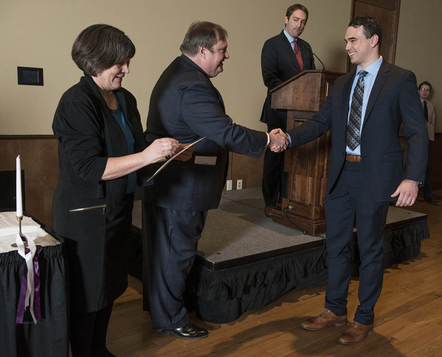 UW-Madison School of Pharmacy Dean Steven M. Swanson shakes hand with a 2018 Rho Chi Pharmacy Honor Society member, during the Initiation Ceremony on Sunday, February 25, 2018, at the Union South.