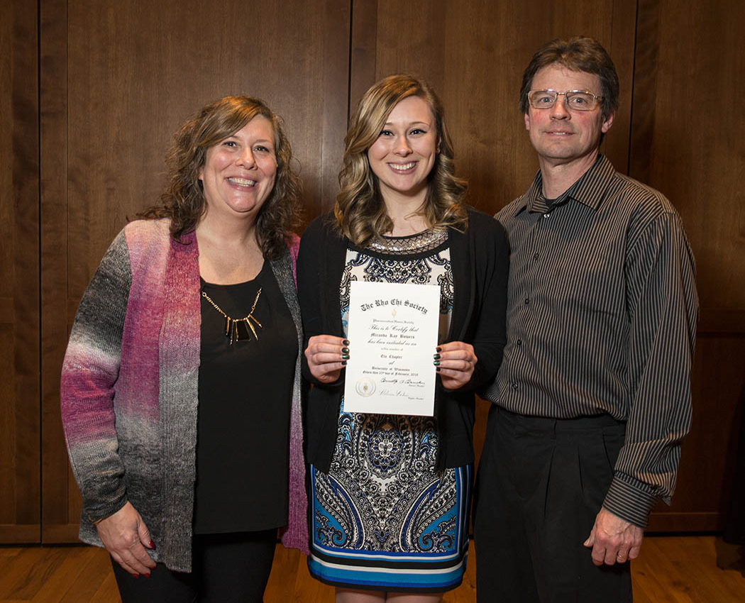 2018 Rho Chi Pharmacy Honor Society member Miranda Bowers, poses with her parents during the Initiation Ceremony on Sunday, February 25, 2018, at the Union South.