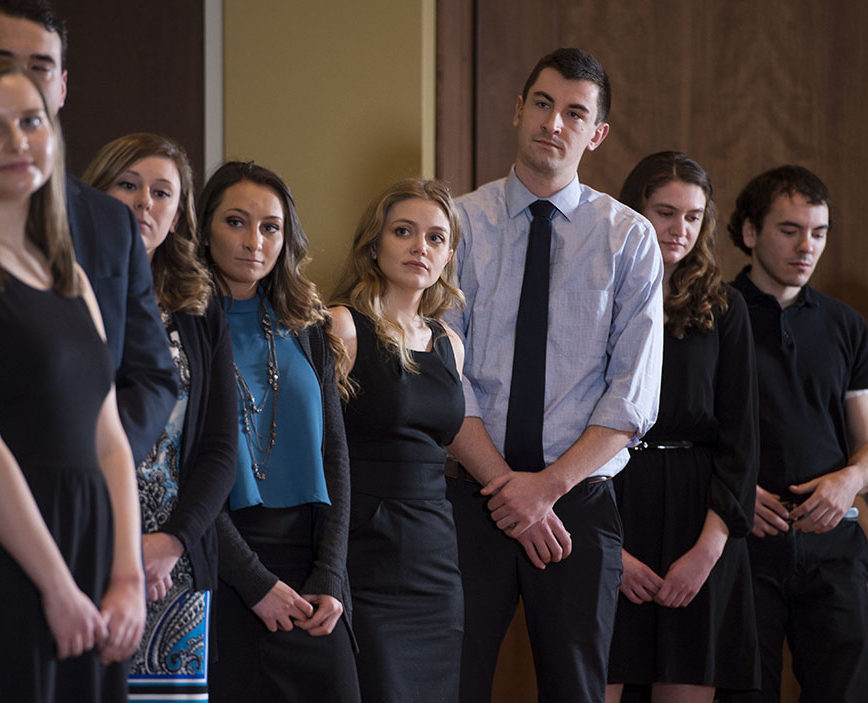 2018 Rho Chi Pharmacy Honor Society initiates wait in line to receive their certificates at the Initiation Ceremony on Sunday, February 25, 2018, at Union South.