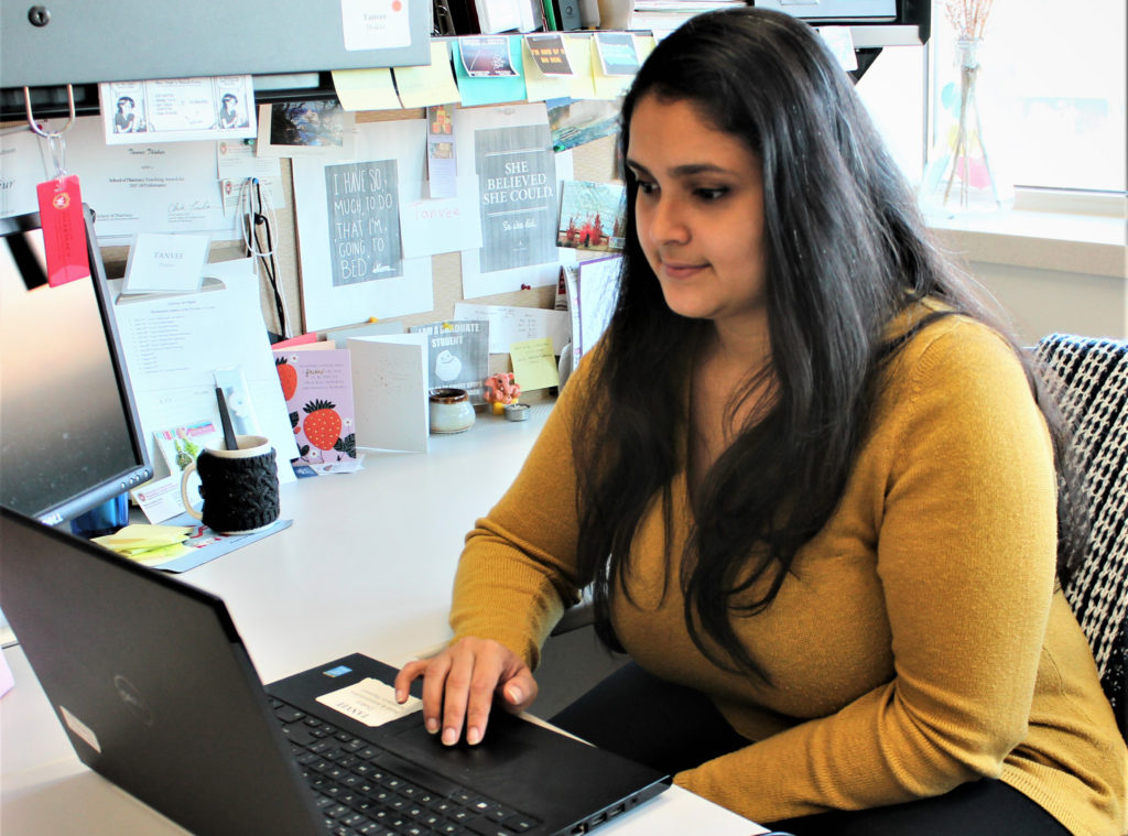 Tanvee Thakur working at her computer.