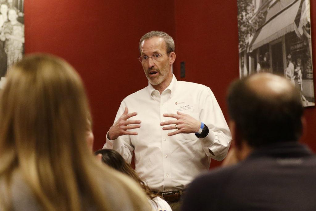Professor David Mott leads the discussion among alumni.