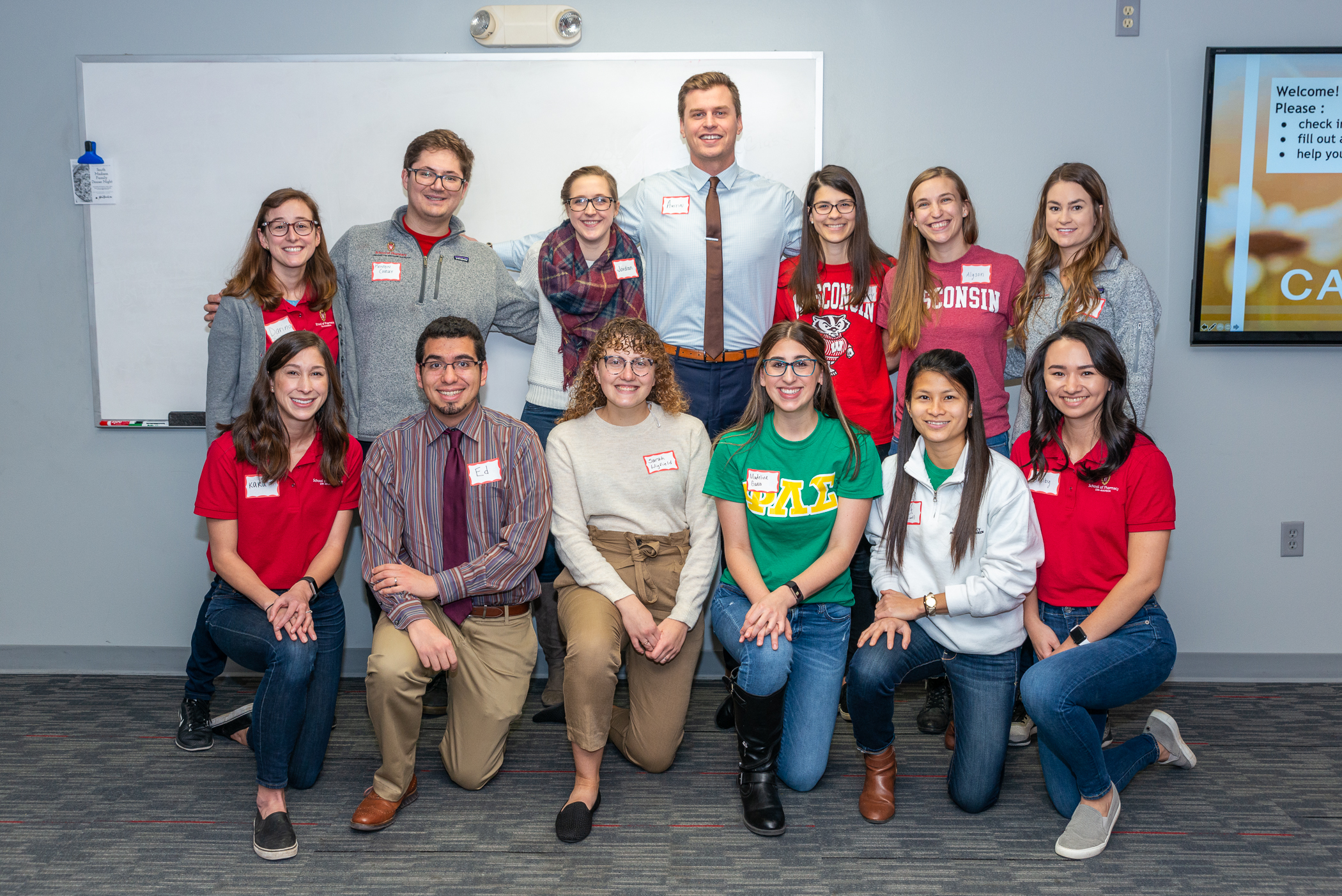 Group photo of students in PLS with Assistant Professor Ed Portillo at the caregiver training.