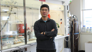 Weiping Tang in his lab at the School of Pharmacy