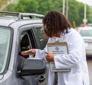 Yolanda Tolson speaking with a patient in a vehicle