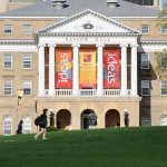 Pedestrians walk across Bascom Hill at the University of Wisconsin-Madison.