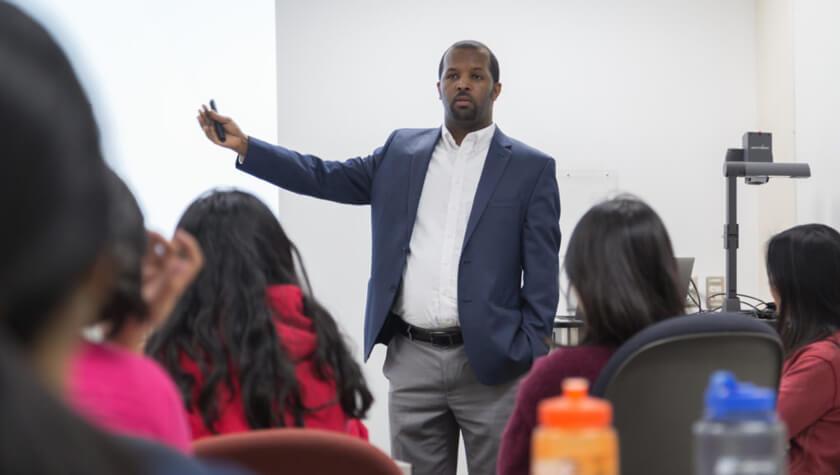 Ephrem Abebe presenting to current students.