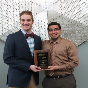 Student Senate Chairperson, Daniel Bruckbauer, DPH-4, (left) presents Edward Portillo, assistant faculty associate in the Pharmacy Practice Division, with the 2016-2017 Student Senate Teaching Excellence Award.