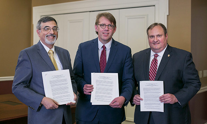AIHP and WHS representatives sign an Memorandum of Understanding (MOU) at the Wisconsin Historical Society in Madison, Wisconsin on June 16, 2017 : Greg Higby, Matthew Blessing, Dean Steven M. Swanson
