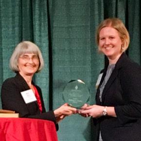 Melissa Forbes accepts award