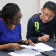 Professor Olayinka Shiyanbola (left) discusses