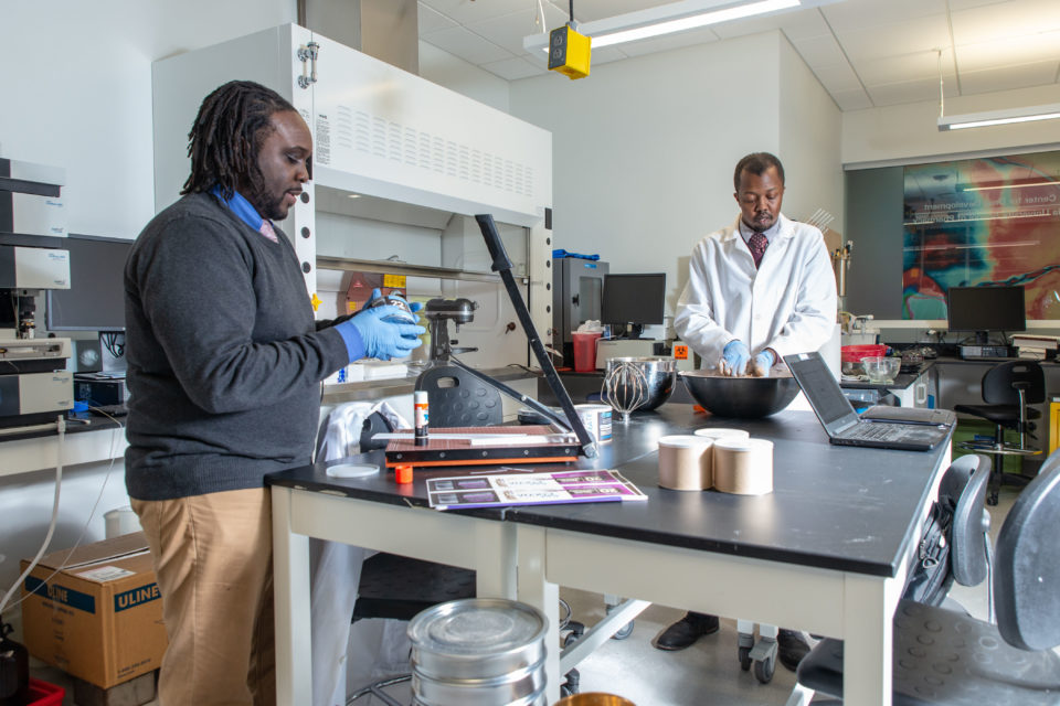 Kwadwo Owusu-Ofori (PhD '10) and Walter Matthews prepare and package the Satori Food Project products within a compounding lab space at the UW–Milwaukee Innovation Campus.