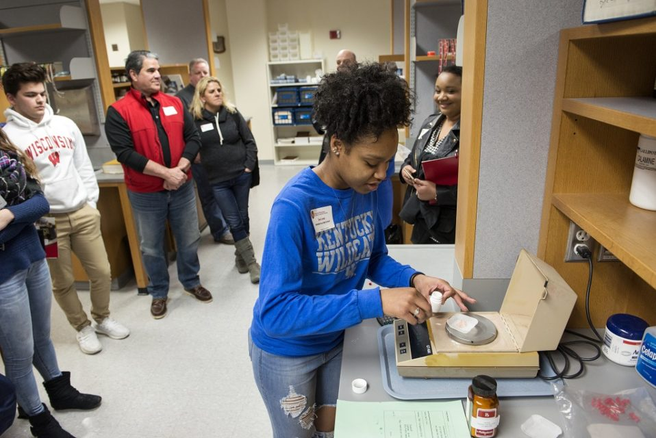 High school student experiences the Dispensing Lab