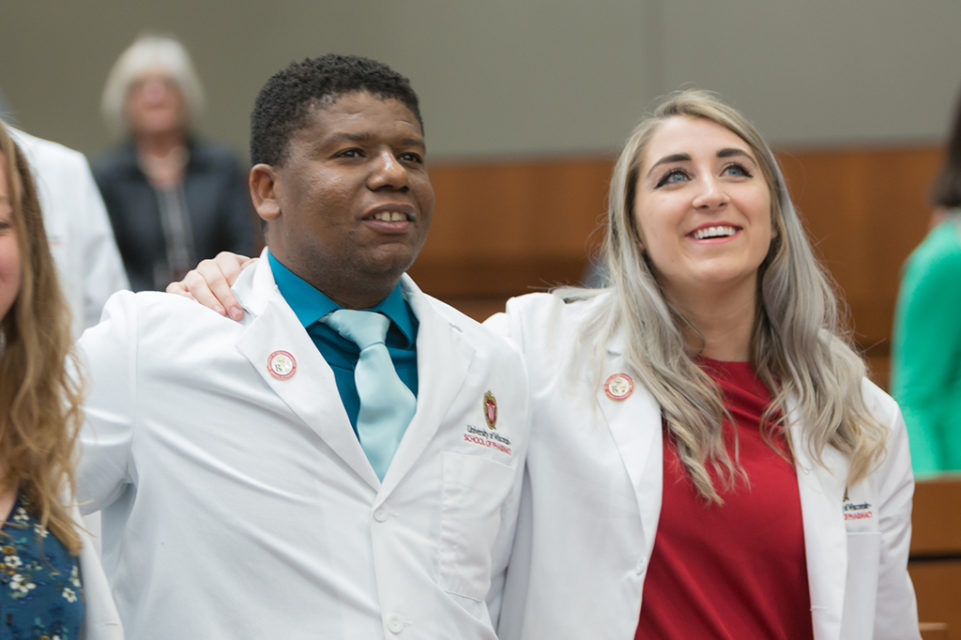 Student pharmacists celebrate their achievement during the ceremony.