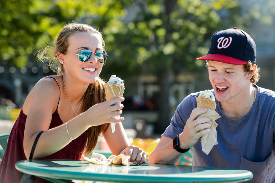 Its a melty race to the finish as recent Middleton High School graduates and local residents Logan Welti and Davis Bunz enjoy cones of Babcock Dairy ice cream at the Memorial Union Terrace at the University of Wisconsin-Madison during a warm summer afternoon on July 26, 2016. Bunz will be an incoming first-year student starting at UW-Madison this fall. (Photo by Jeff Miller/UW-Madison)