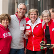 A group of alumni at the School of Pharmacy tailgate.