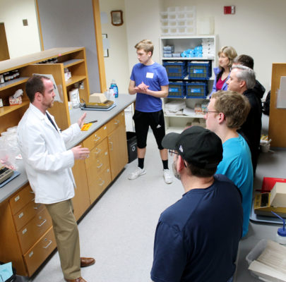 Preview day visitors tour a lab.