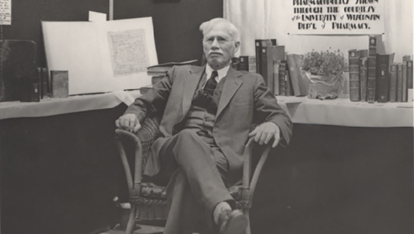 Black and white image of Edward Kremers in a chair.