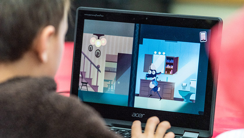 A child playing Assistant Professor Olufunmilola Abraham's video game to teach youth about opioid medication safety