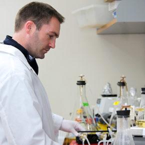 Associate Professor Warren Rose working in his lab