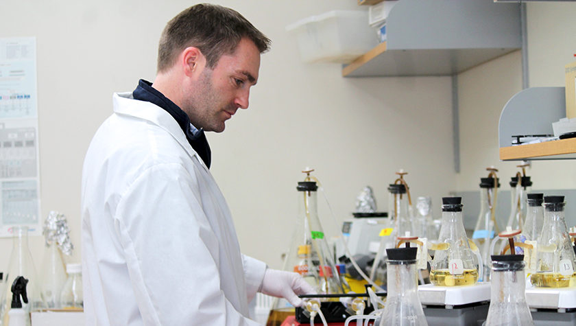 Associate Professor Warren Rose working in his lab