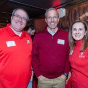 School of Pharmacy alumni  Ryan Miller (left) and Jenny Tempelis (right) co-hosted the La Crosse Pharmacy Alumni event with Professor David Mott (center).