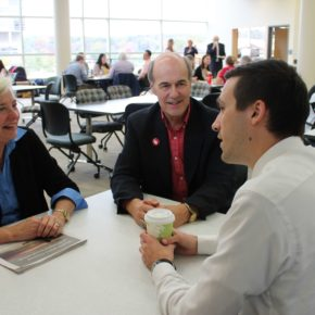 Duane Kirking (BS '74), center, with wife Marilyn, meet with their scholarship recipient, PharmD student Eric Friestrom.