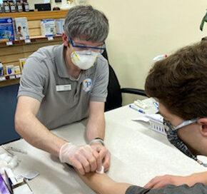 Dan Ricci conducting a TB test on a PharmD student.