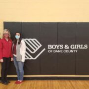 Associate Professor Olayinka Shiyanbola, Professor Beth Martin, and Assistant Professor Marina Maes volunteer at the vaccination clinic at the Boys & Girls Allied Club in Fitchburg.