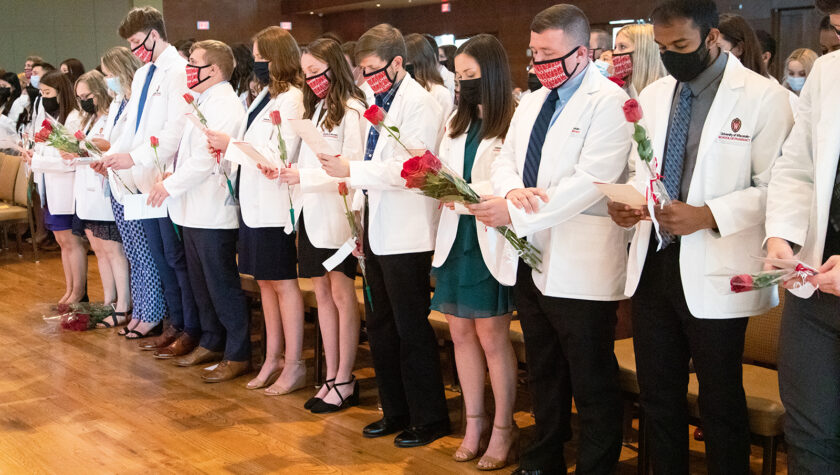 PharmD students in the Class of 2025 take the Oath of the Pharmacist at their White Coat Ceremony.