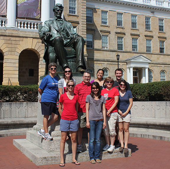 members of the marker lab stand in front of a statue of abraham lincoln.